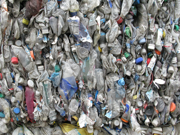 a bale of plastic bottles ready to be shipped to Asia for recycling