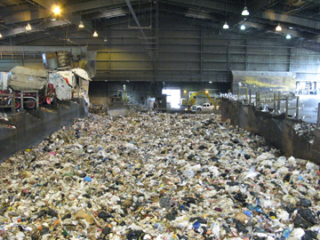 garbage trucks unloading into the pit