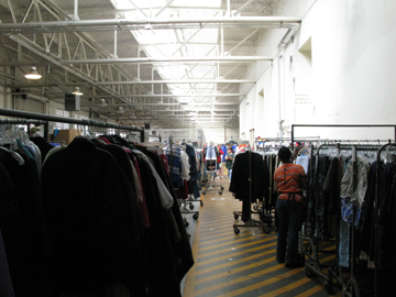 racks of clothes sorted for distribution to San Francisco's Goodwill retail stores