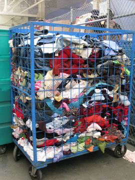 piles of rejected clothing at Goodwill