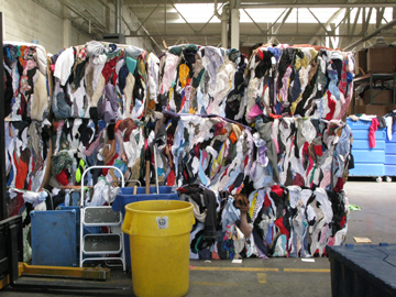 bales of clothing are ready for the scrap/rag trade