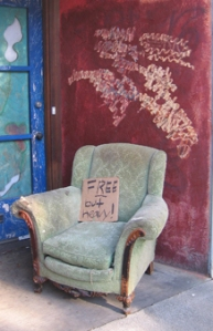 a free chair left on the sidewalk
