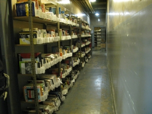 shelves of books ready for online sale in the basement of Goodwill of San Francisco