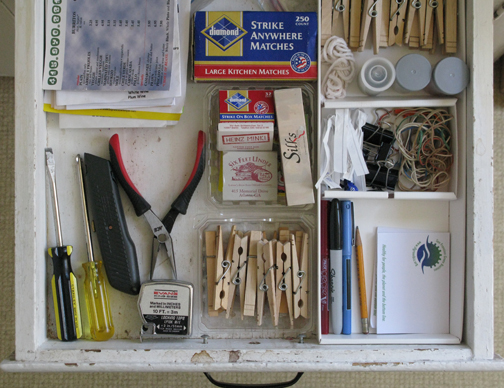 organizing a kitchen junk drawer using trash