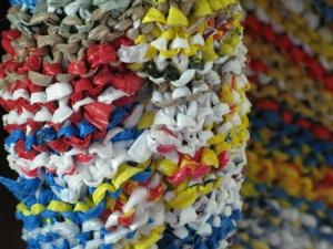 knitting single-use plastic bags to make a reusable bag