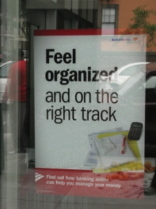 """Bank of America window sign reading """"Feel organized and on the right track"""""""