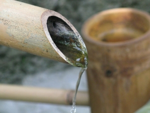 water pours from bamboo spout