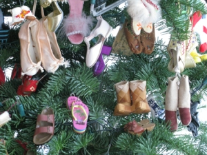 detail of Christmas tree covered in shoes