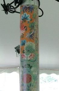 recycled calendar pages used as a decoration in a wedding tent