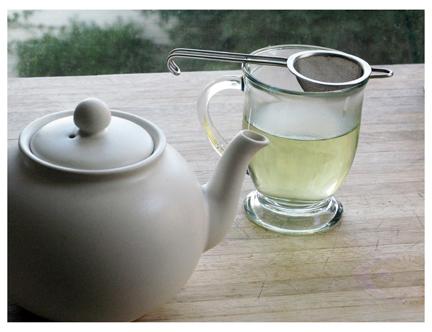 steeping nettle tisane, or herb tea
