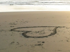 a heart drawn in the sand