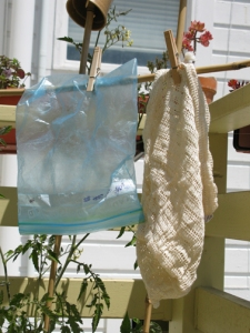 reusable bags hang outside to dry